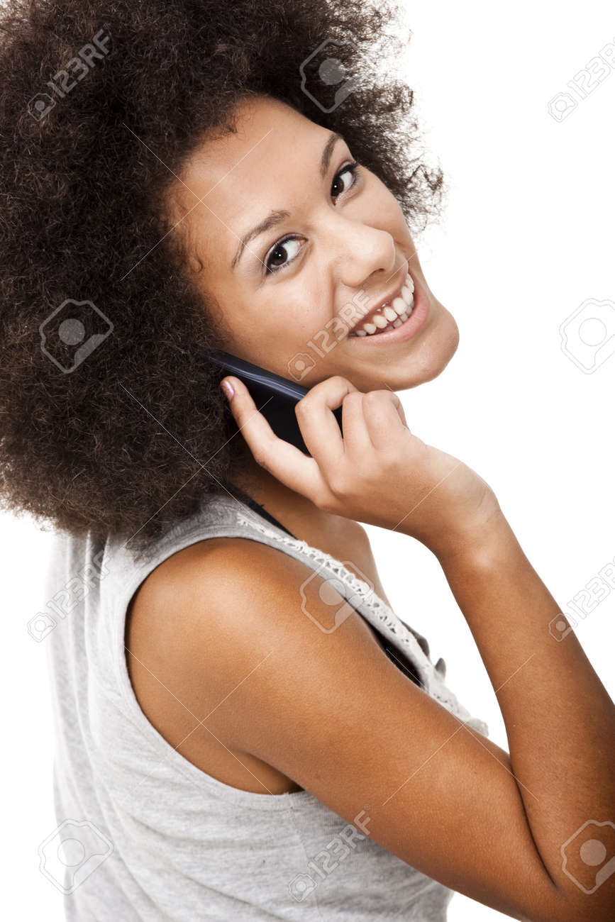 Beautiful African American woman talking on cell phone, isolated on white background Stock Photo - 15264734