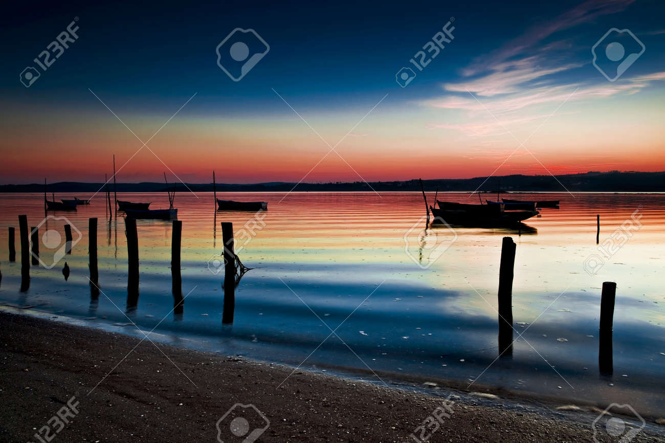 Beautiful landscape of a river and boats at sunset Stock Photo - 17227253
