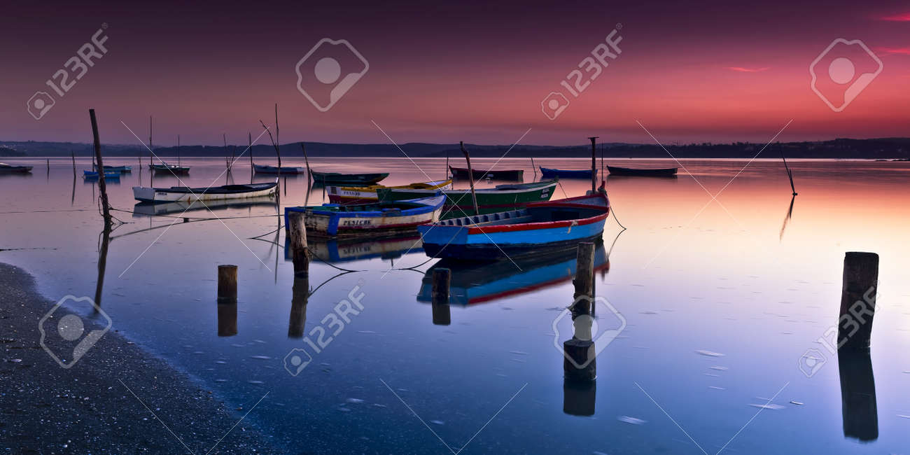 Beautiful landscape of a river and boats at sunset Stock Photo - 17227244