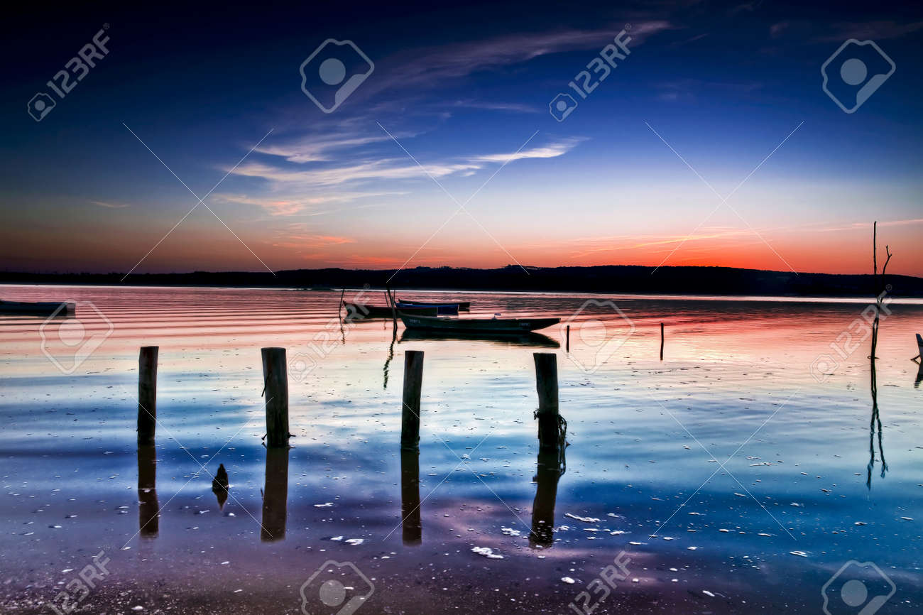 Beautiful landscape of a river and boats at sunset Stock Photo - 17227274