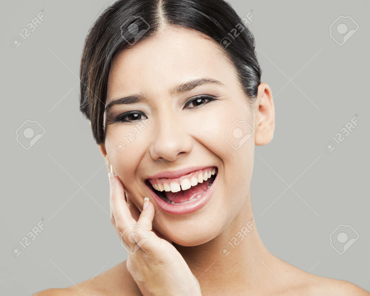 Beauty portrait of young asian woman laughing, isolated over a gray background Stock Photo - 17903515