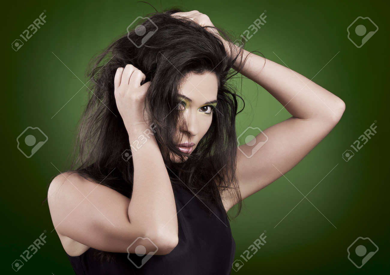 Portrait of a beautiful fashion woman over a green background Stock Photo - 19428630