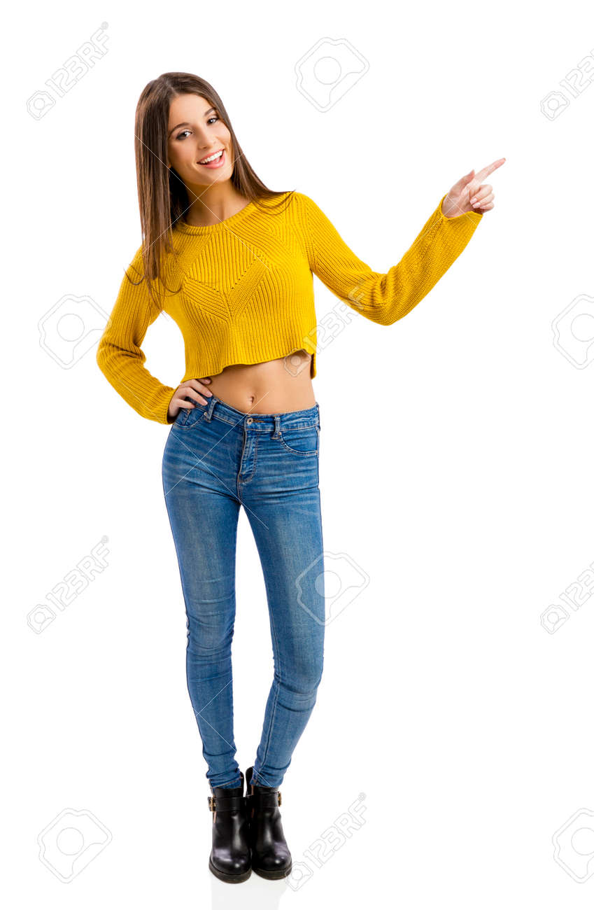 Beautiful and happy teenage girl pointing, isolated over white background - 53599439