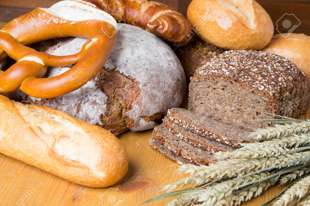 Different Types Of Bread And Bakery Products Such As A Loaf Prezels