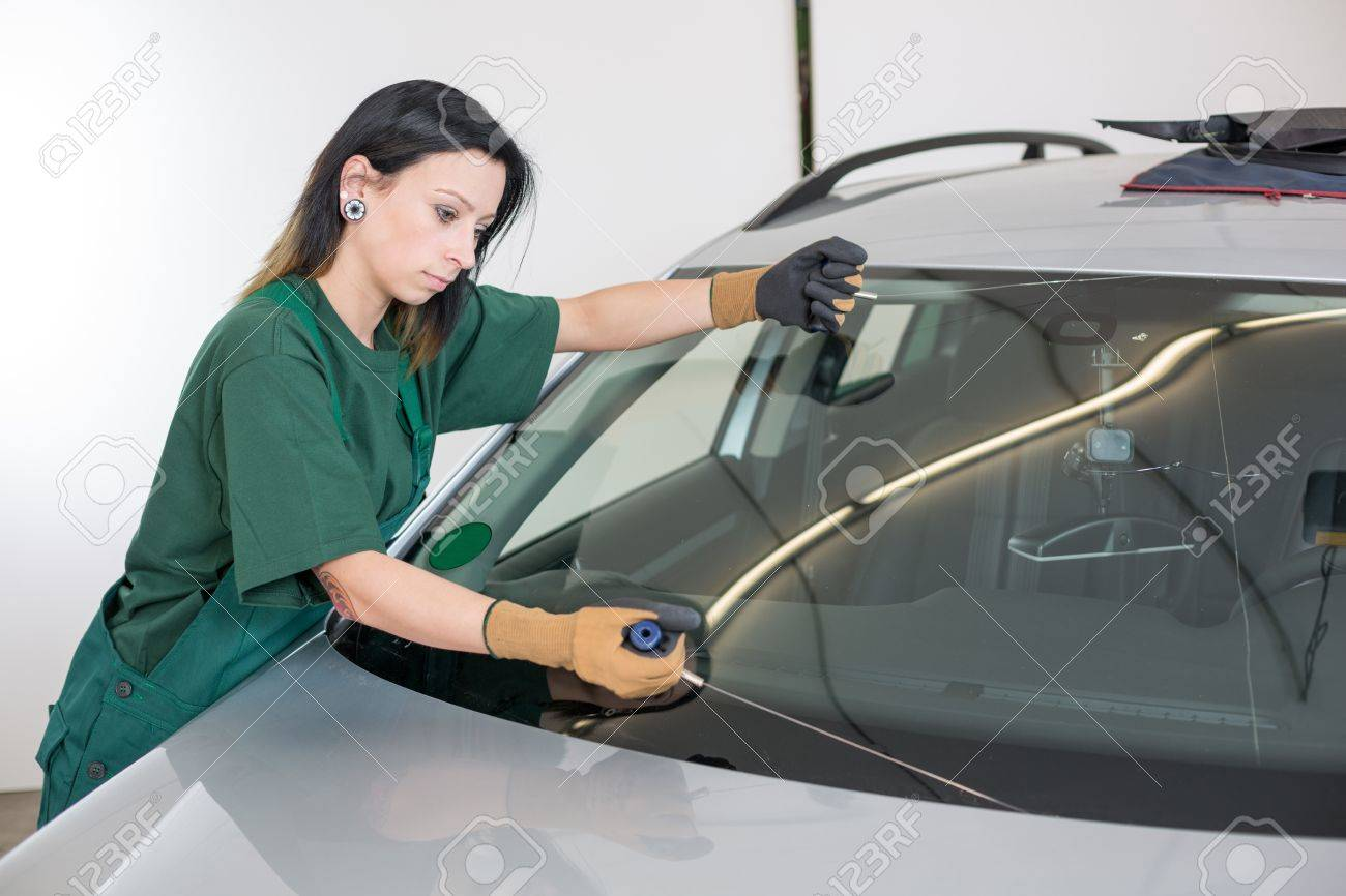 Glazier Cutting Adhesive Of Windscreen With A Wire To Replace ...