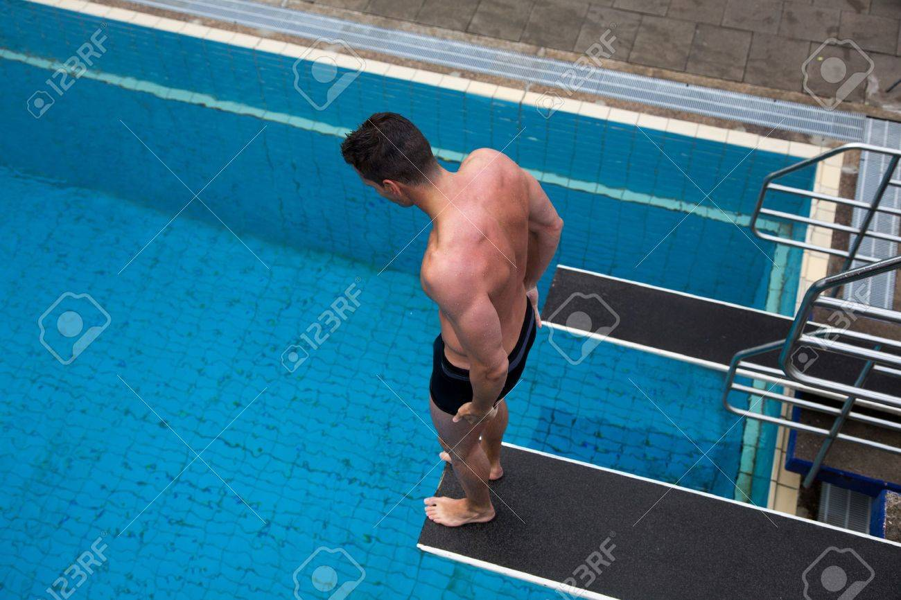 public swimming pools with diving boards. Man With Fear Of Height Standing On Diving Board At Public Swimming Pool Above The Water Pools Boards V