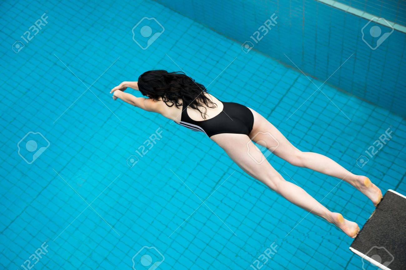 public swimming pools with diving boards. Stock Photo - Woman Jumping From A Diving Board At Public Swimming Pool Pools With Boards I