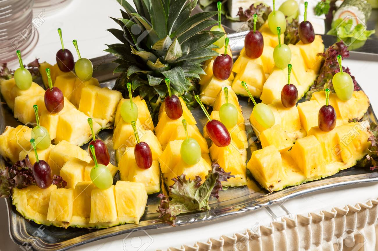 Ananas Buffet buffet with pineapple and grapes appetizers and other fruits.. stock
