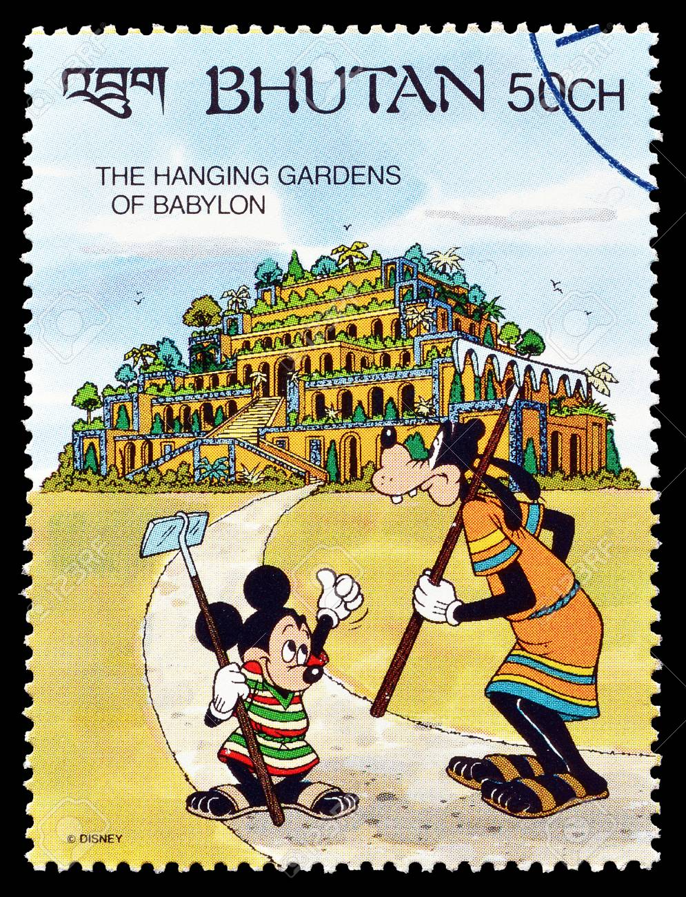 Cancelled Postage Stamp Printed By Bhutan That Shows Mickey Mouse And Goofy Visiting Hanging Gardens