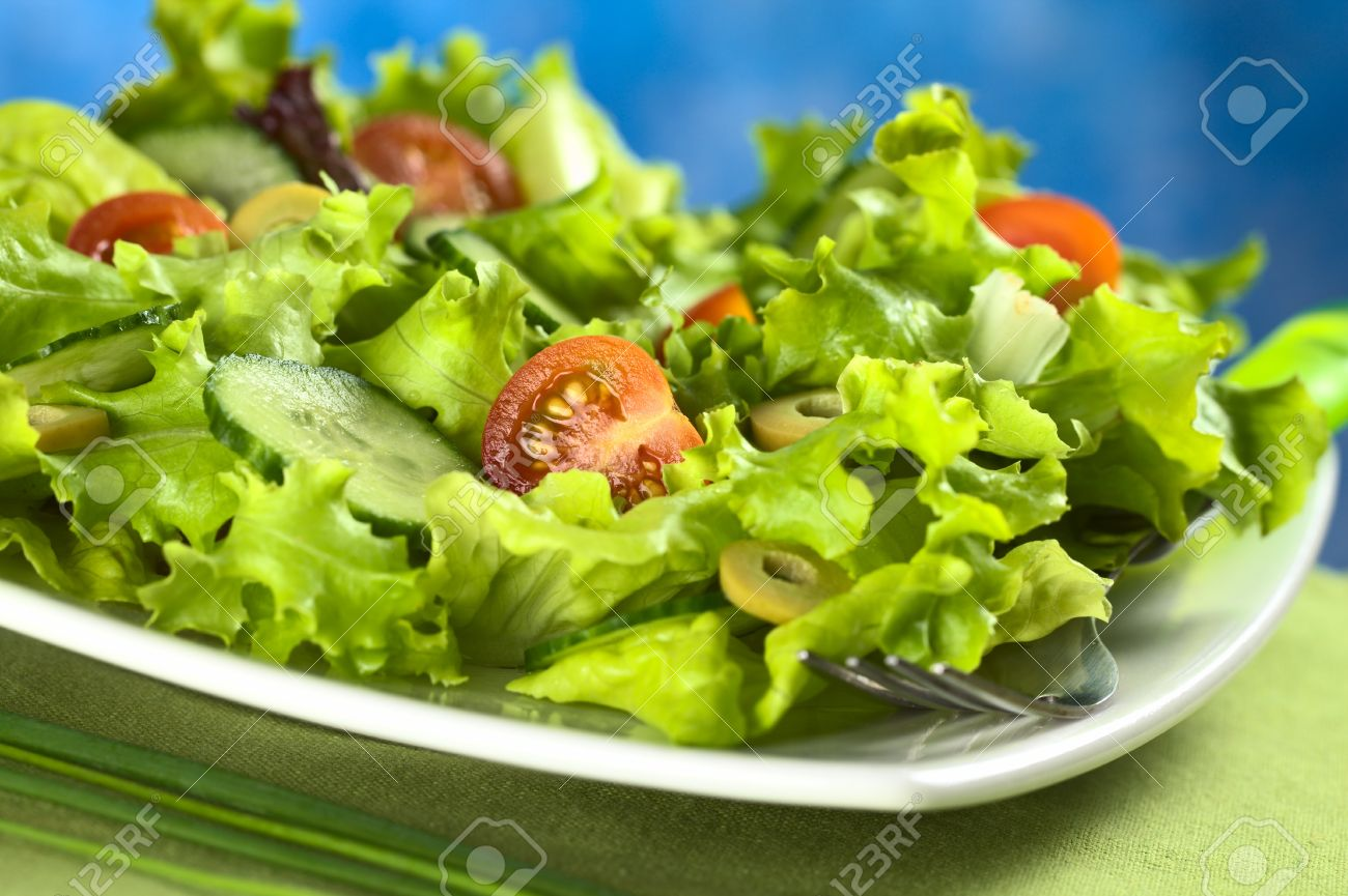 Fresh Vegetable Salad Made Of Cherry Tomato Cuber Green Olives And Lettuce Stock Photo