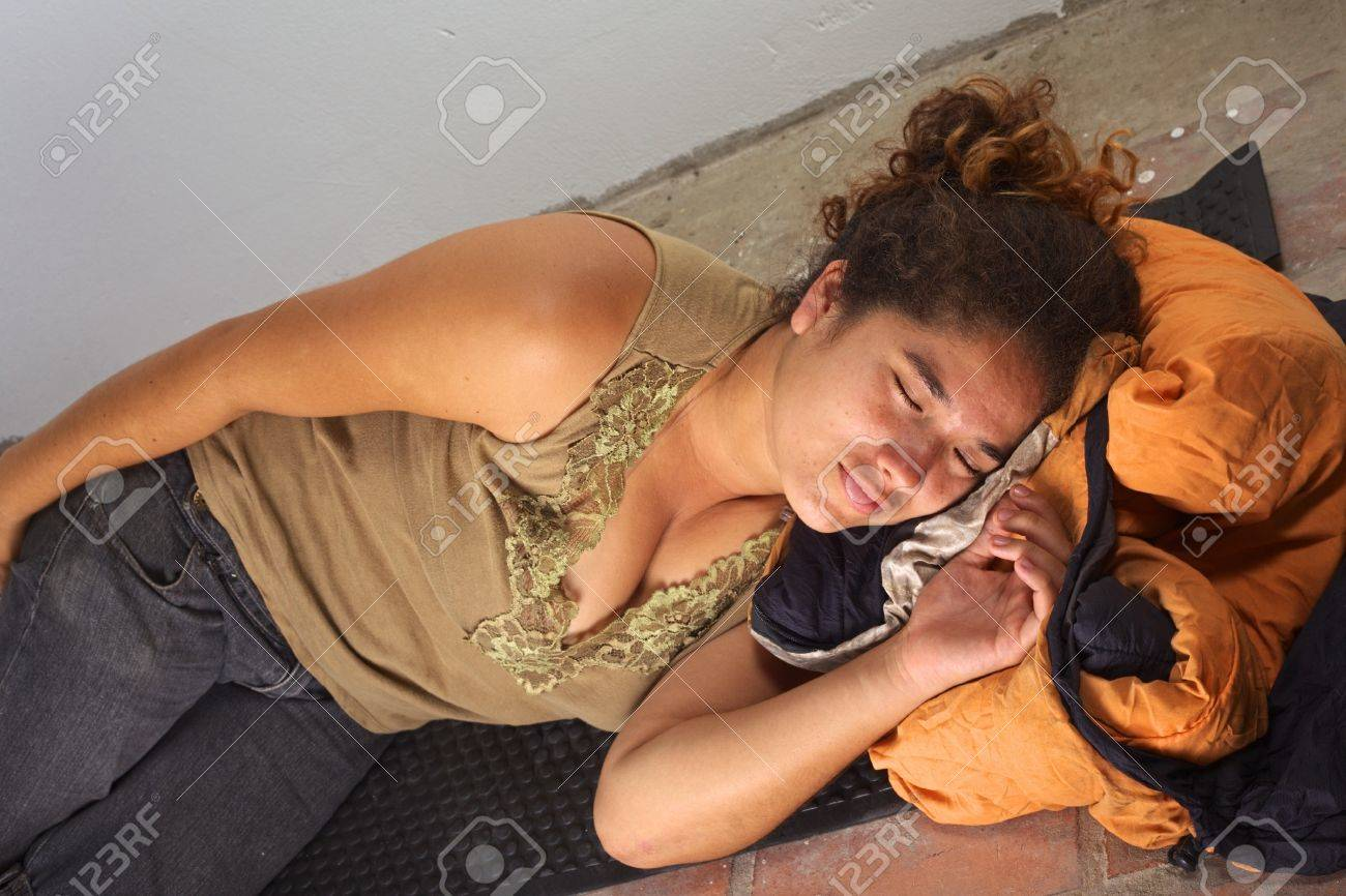 Floor mats to sleep on - Stock Photo Young Peruvian Woman Squatting An Abandoned House Sleeping On Mat And Sleeping Bag On The Floor Selective Focus Focus On The Face Of The