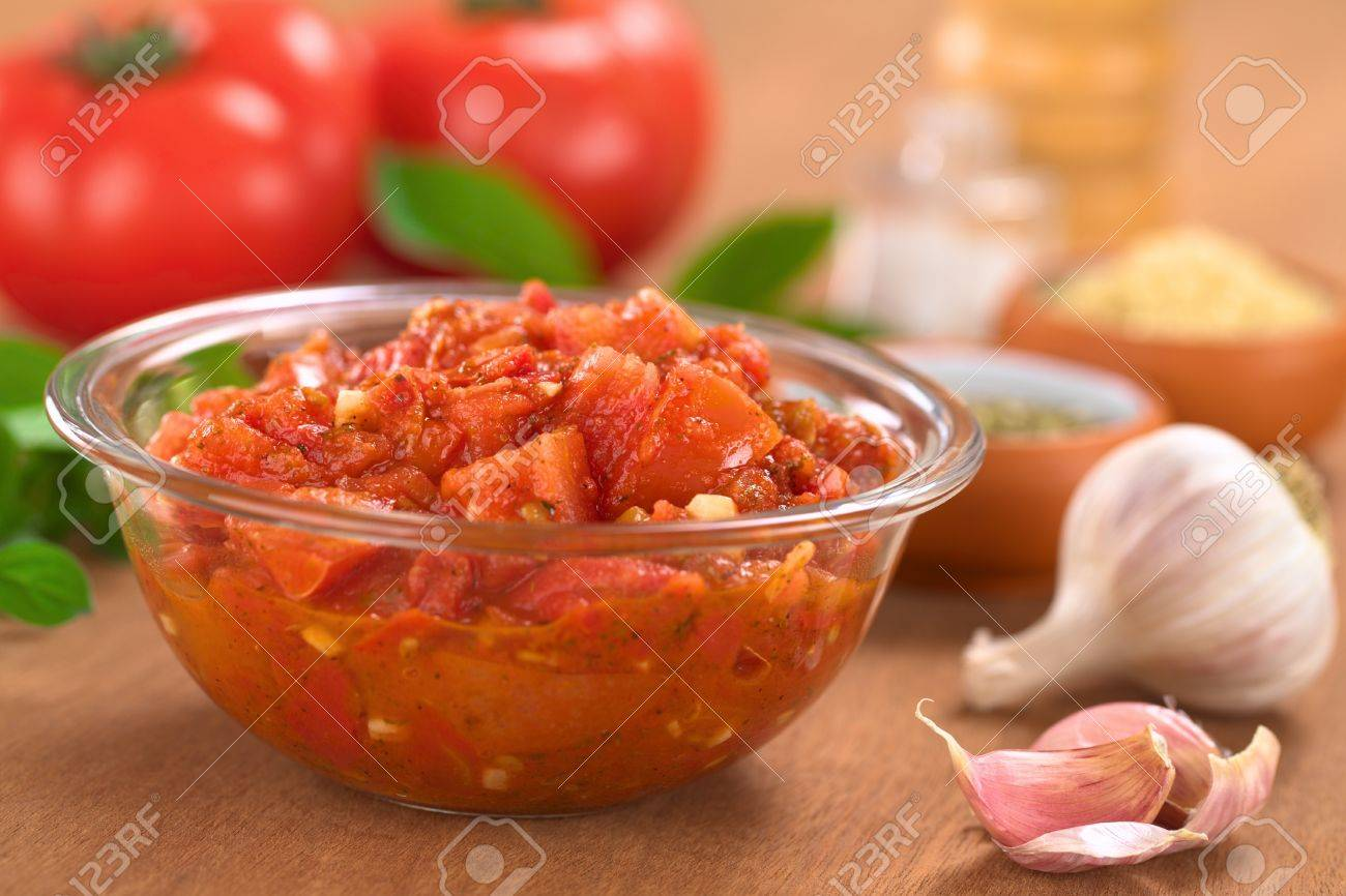 glass bowl of fresh homemade tomato sauce for pizza made of fresh