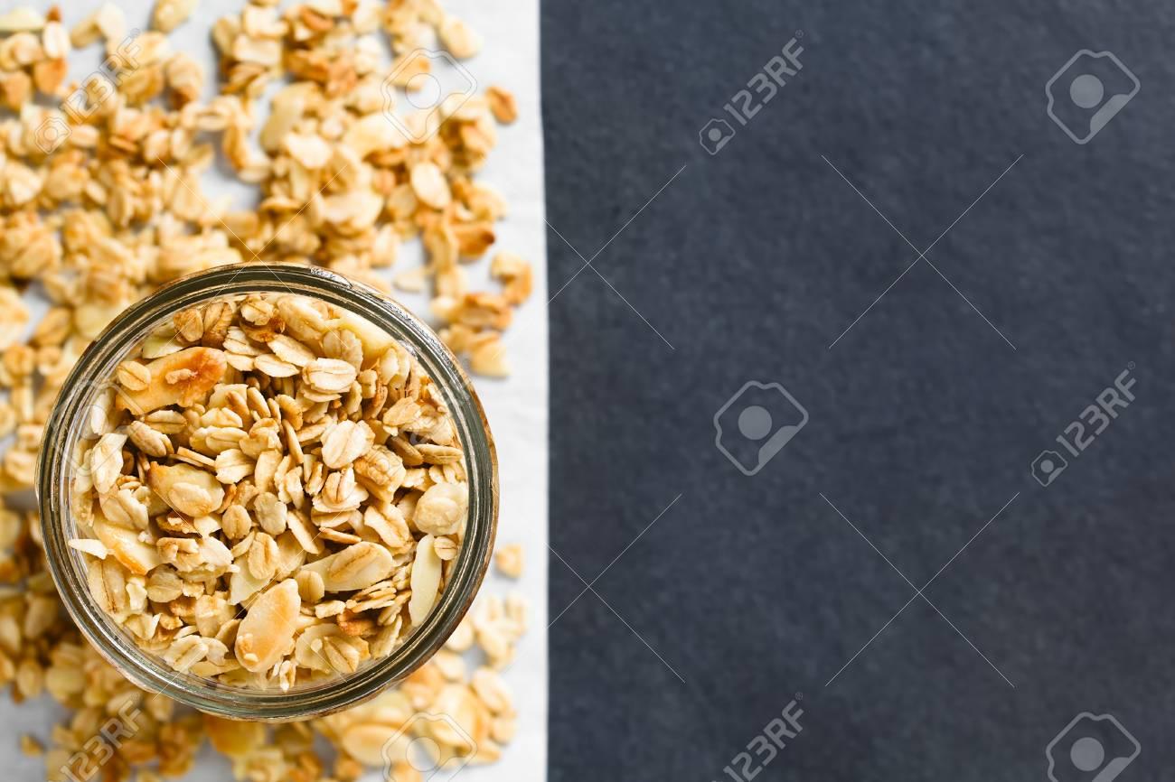 Homemade baked crunchy oatmeal, sliced almond, honey and coconut