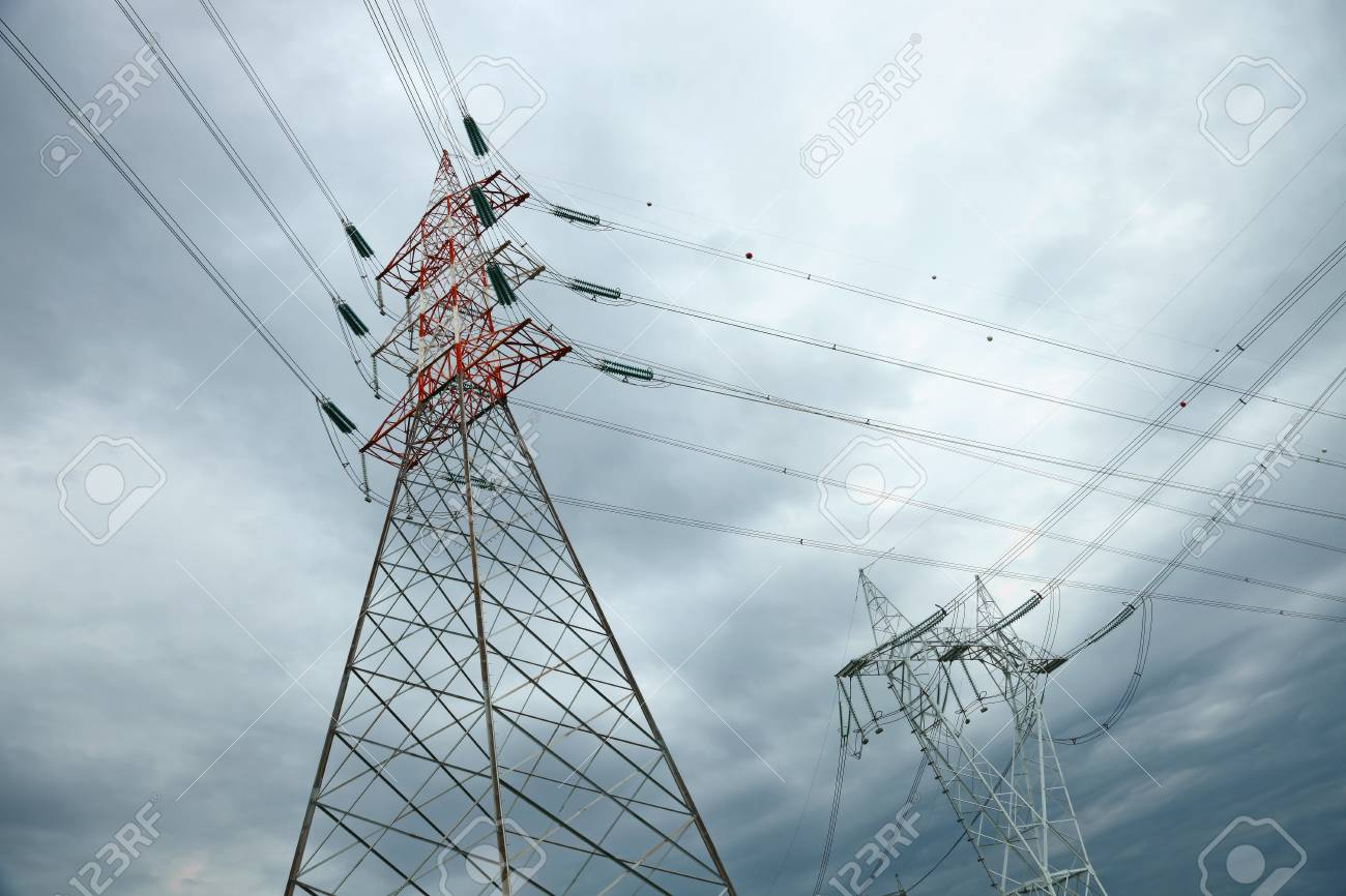 electric high voltage pylon against dramatic sky Stock Photo - 9984693