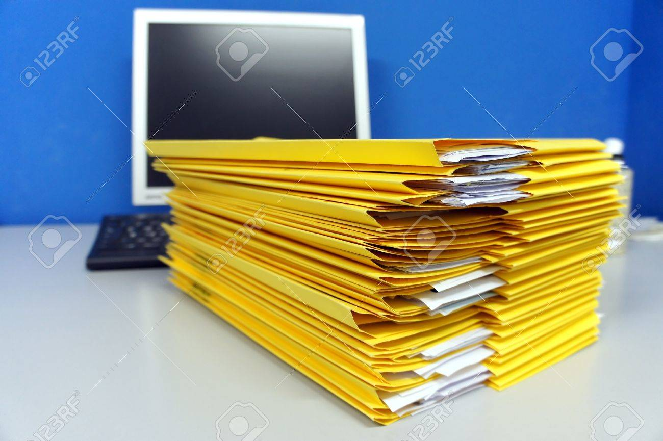 yellow file and folders stack on office desk Stock Photo - 13187134