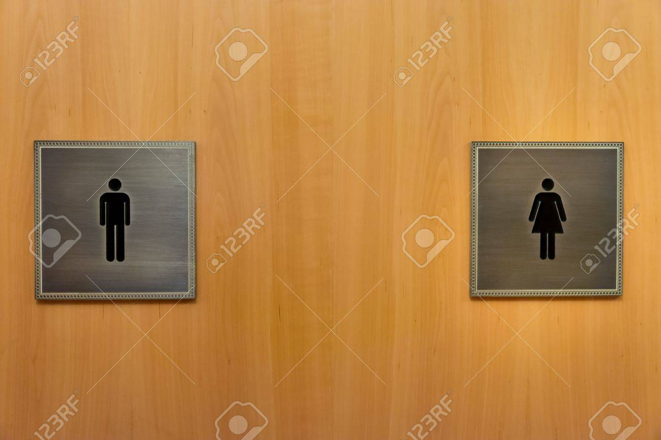 men and woman wc sign on wood wall Stock Photo - 16402288