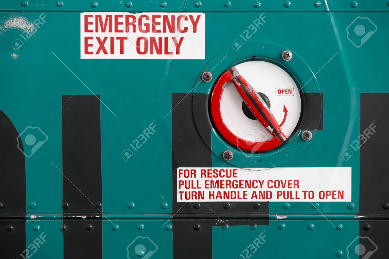 grungy red emergency exit text on helicopter Stock Photo - 17612513