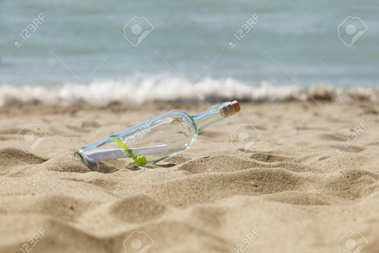 a message or letter in a bottle on the beach stock photo 21594332