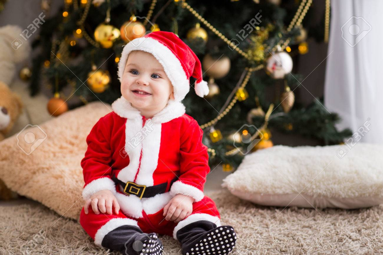 funny baby boy weared in Santa hat with golden Christmas ball Stock Photo -  70056263 03c9744271a