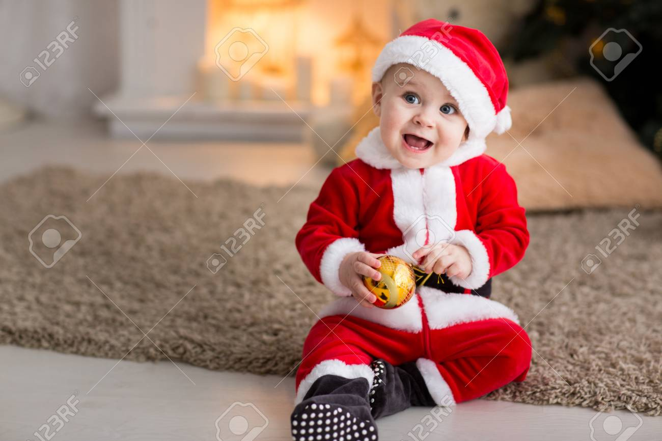 funny baby boy weared in Santa hat with golden Christmas ball Stock Photo -  70202808 33897df3a9f