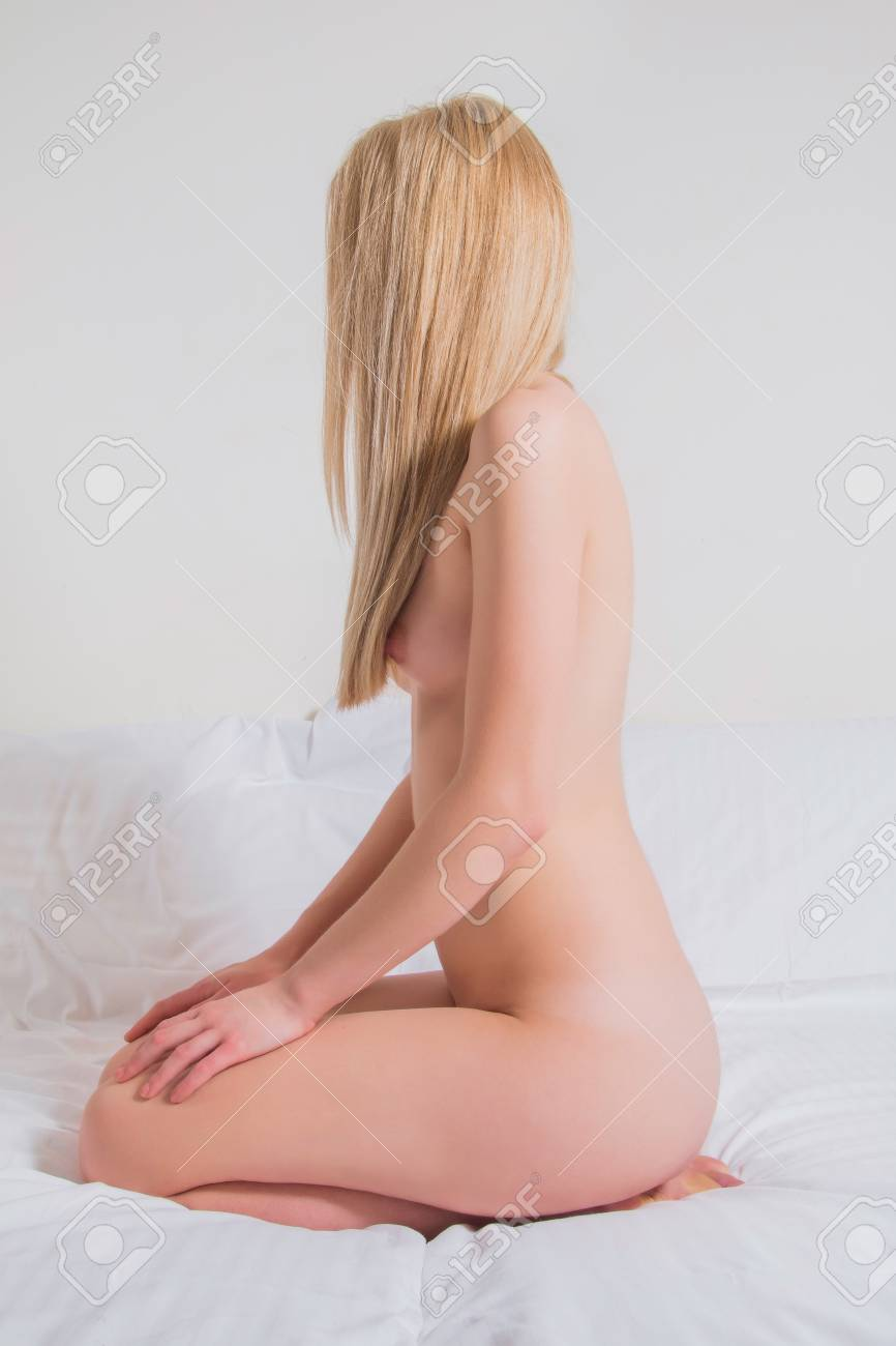 most popular casual shoes best online Young sexy nude girl sitting on the bed, face covered with hair,..
