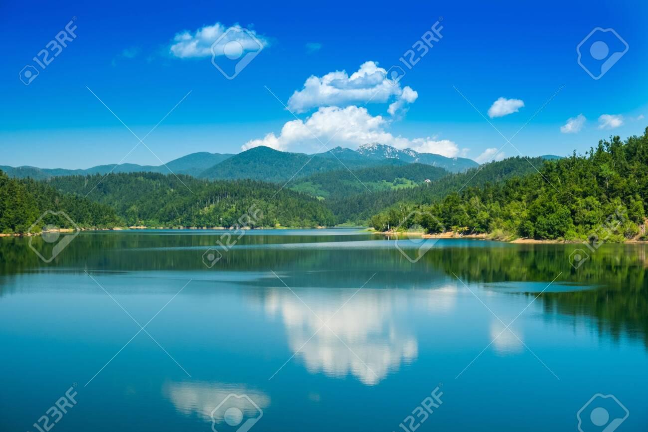 Croatia, beautiful lake in Gorski kotar, Lokve, Risnjak mountain in background, reflection in watter - 128657957
