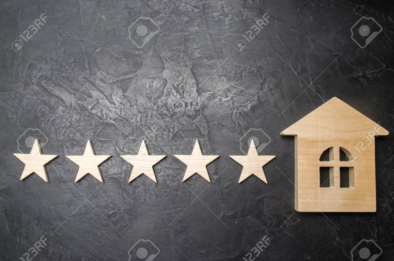 13ec9740f6 Five stars and a wooden house on a gray concrete background. The concept of  the