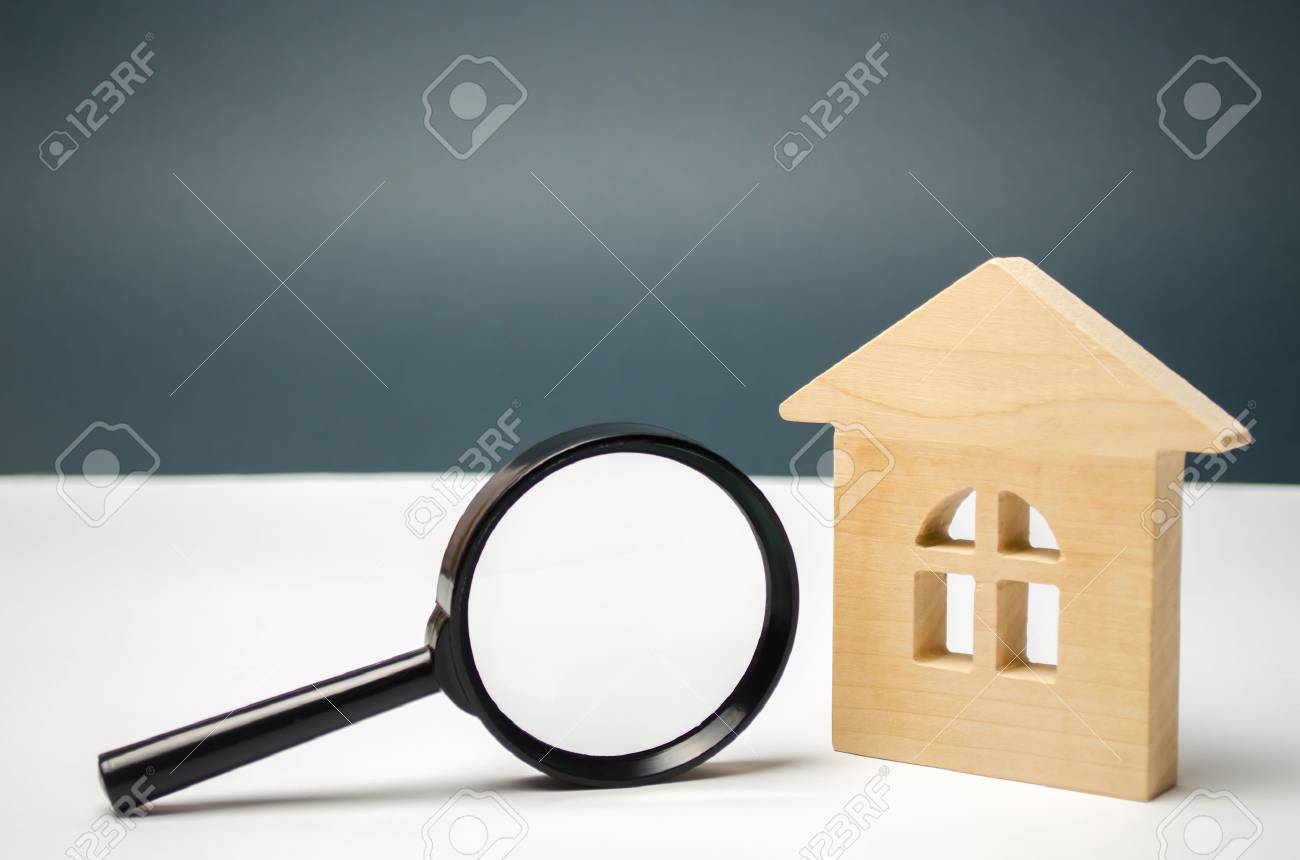 Wooden house and magnifying glass. Property valuation. Choice of location for the construction. House searching concept. Search for housing and apartments. Real estate concept. Home appraisal - 115600386