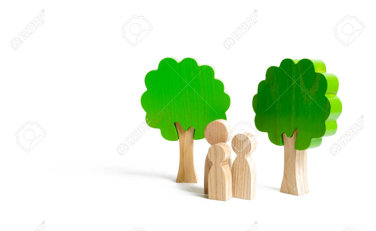Family figures are standing near the trees  Walk in nature, relaxation