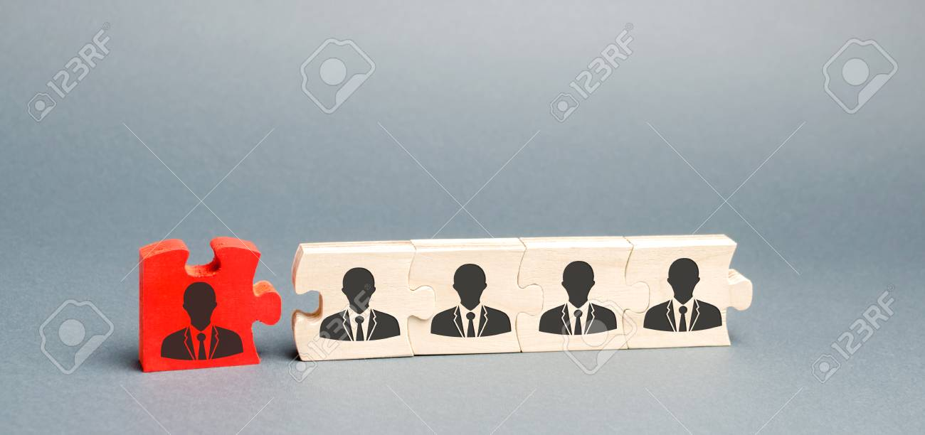 Wooden puzzles with the image of workers. The concept of personnel management in the company. Dismissing an employees from a team. Demotion. Bad worker. Staff cuts. Human resources. Demote - 122679515
