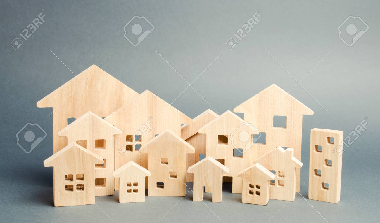 Miniature wooden houses. Real estate. City. Agglomeration and urbanization. Real Estate Market Analytics. Demand for housing. Rising and falling home prices. The growth of the city and its population - 124956033