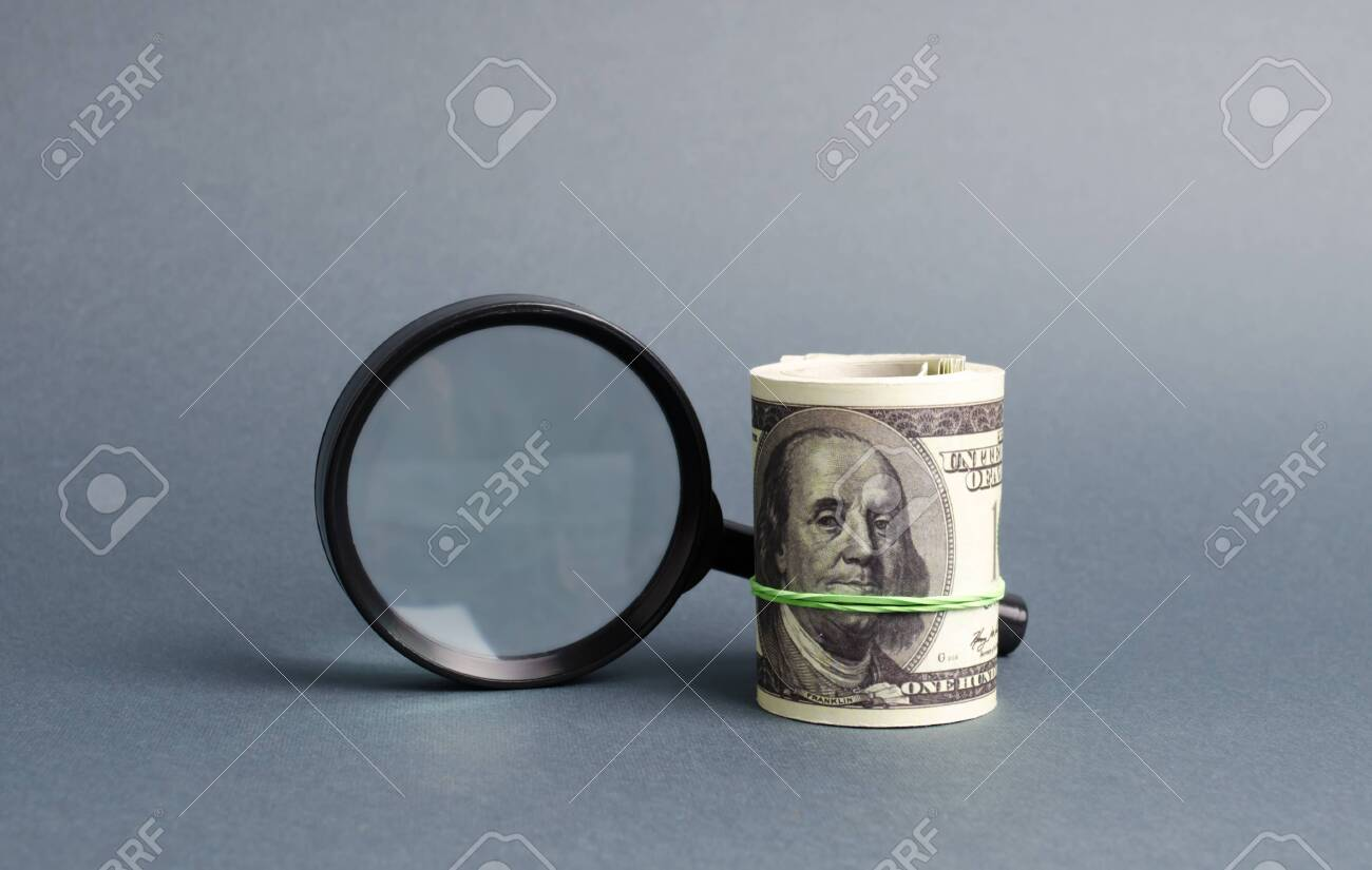 Magnifying glass and a bundle of money. Concept of fundraising, attracting investments. Loan to paycheck, urgent loans. The study of sources of profit, money laundering, offshore. Financial monitoring - 125849804