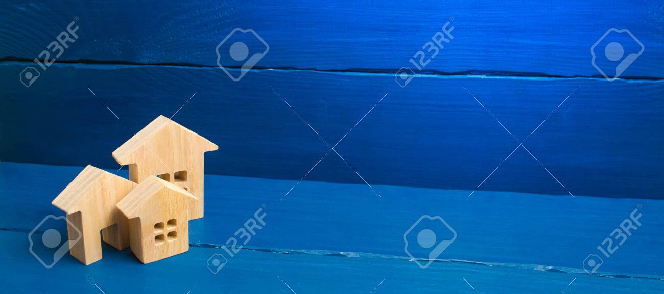 Buying and selling of real estate, construction. Three houses on a blue background. Apartments and apartments. City, settlement. Minimalism. presentations. real estate market. banner, place for text - 125849904