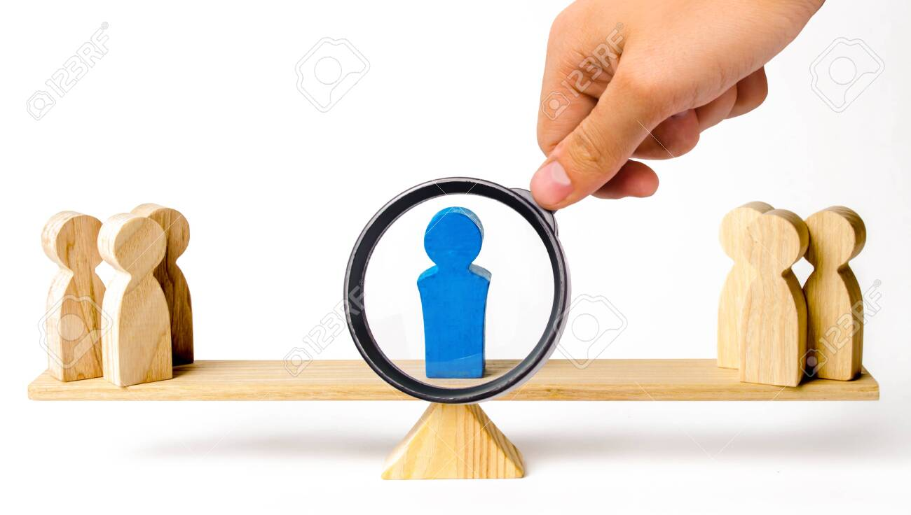 A magnifying glass looks at a leader stands on the scales between two groups of people. Resolving conflict situations. The union of two opposing sides. Arbitrator and mediator services. - 131418863
