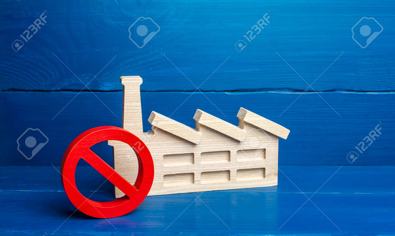 Factory industrial plant and red prohibition symbol NO. Free zone from harmful heavy industry. Environmental quotas and restrictions on environmental pollution. Bankruptcy, liquidation of enterprises. - 159020460