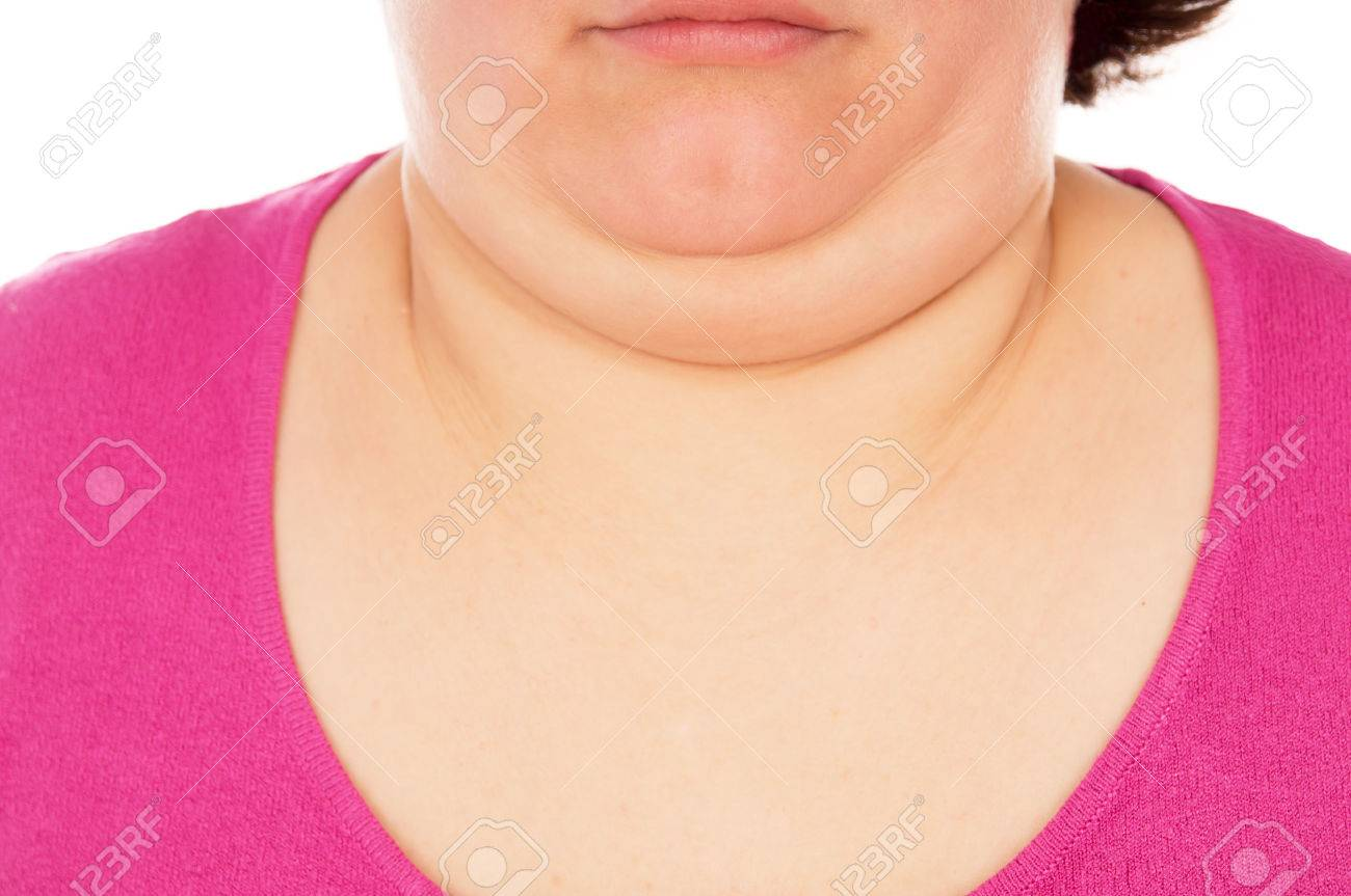 Full woman shows the second chin, isolated on white background - 36035726