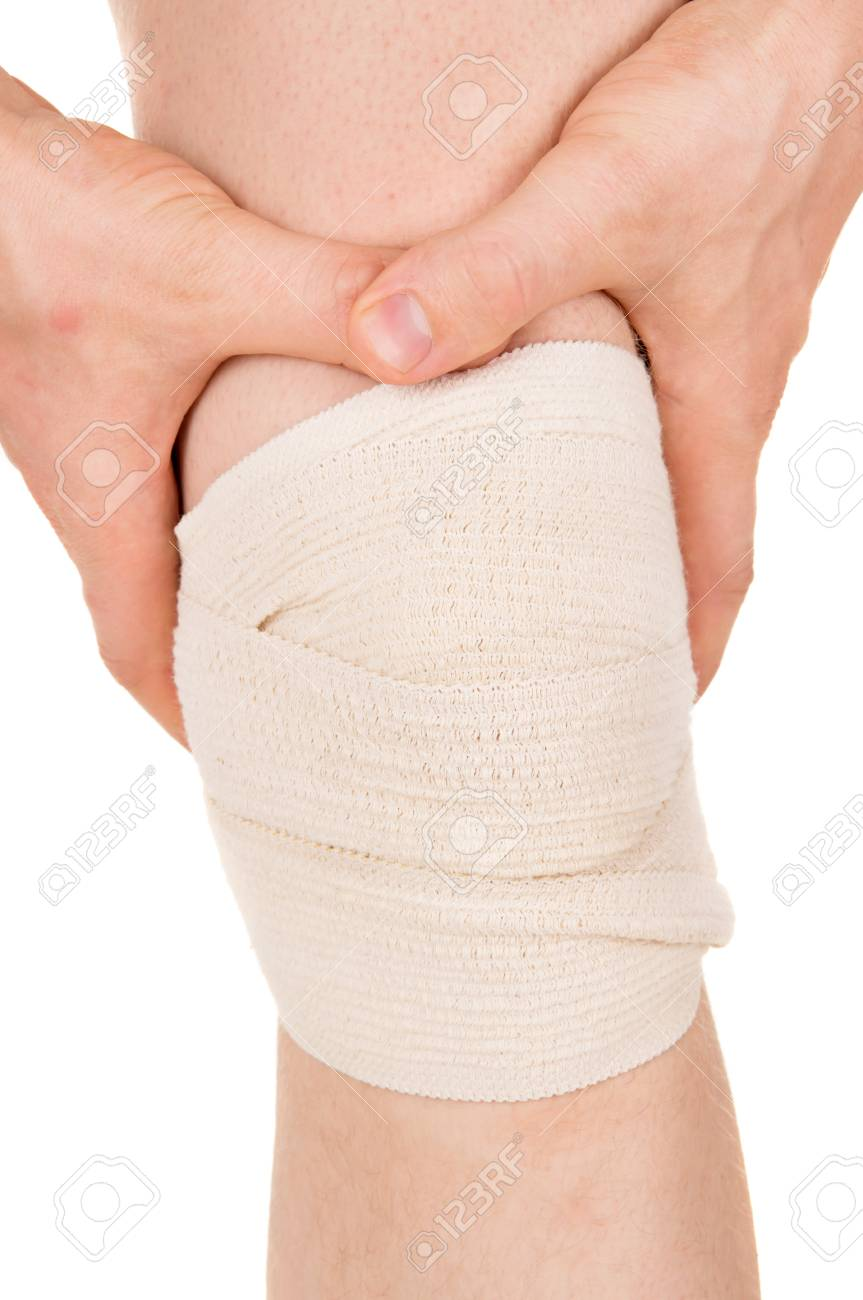 Bandaging The Knee With An Elastic Bandage Isolated On White