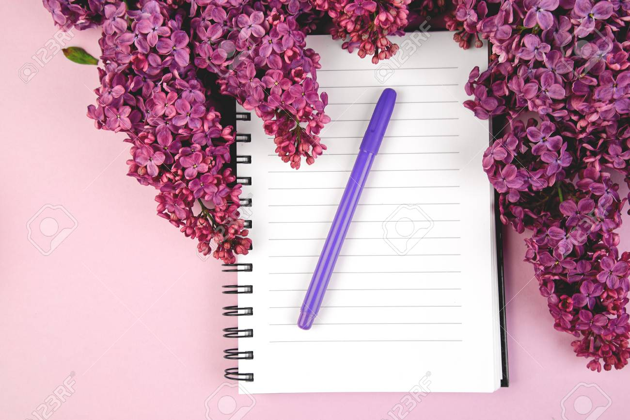 Branches Of Spring Flowers Bouquet Blooming Lilac On Purple Table