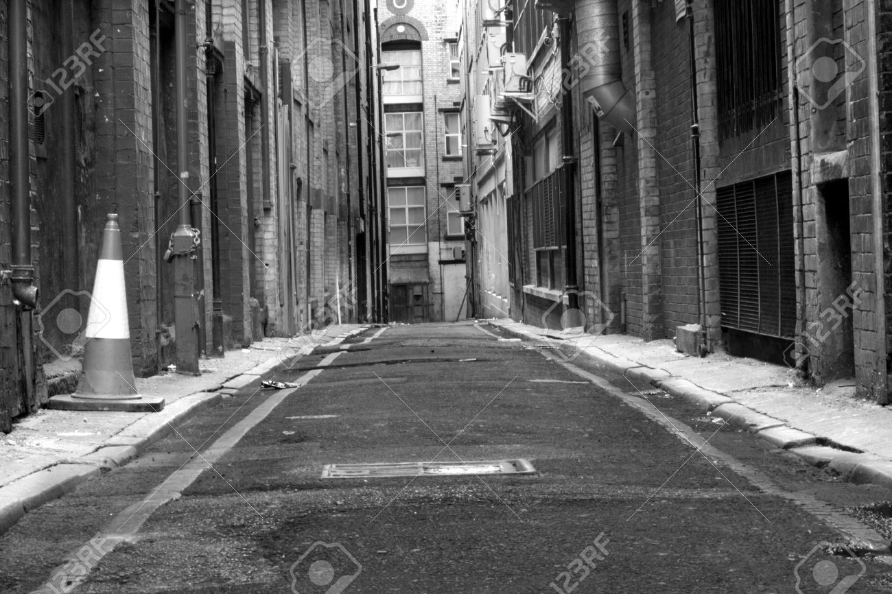 Looking down a long dark back alley - 3348295