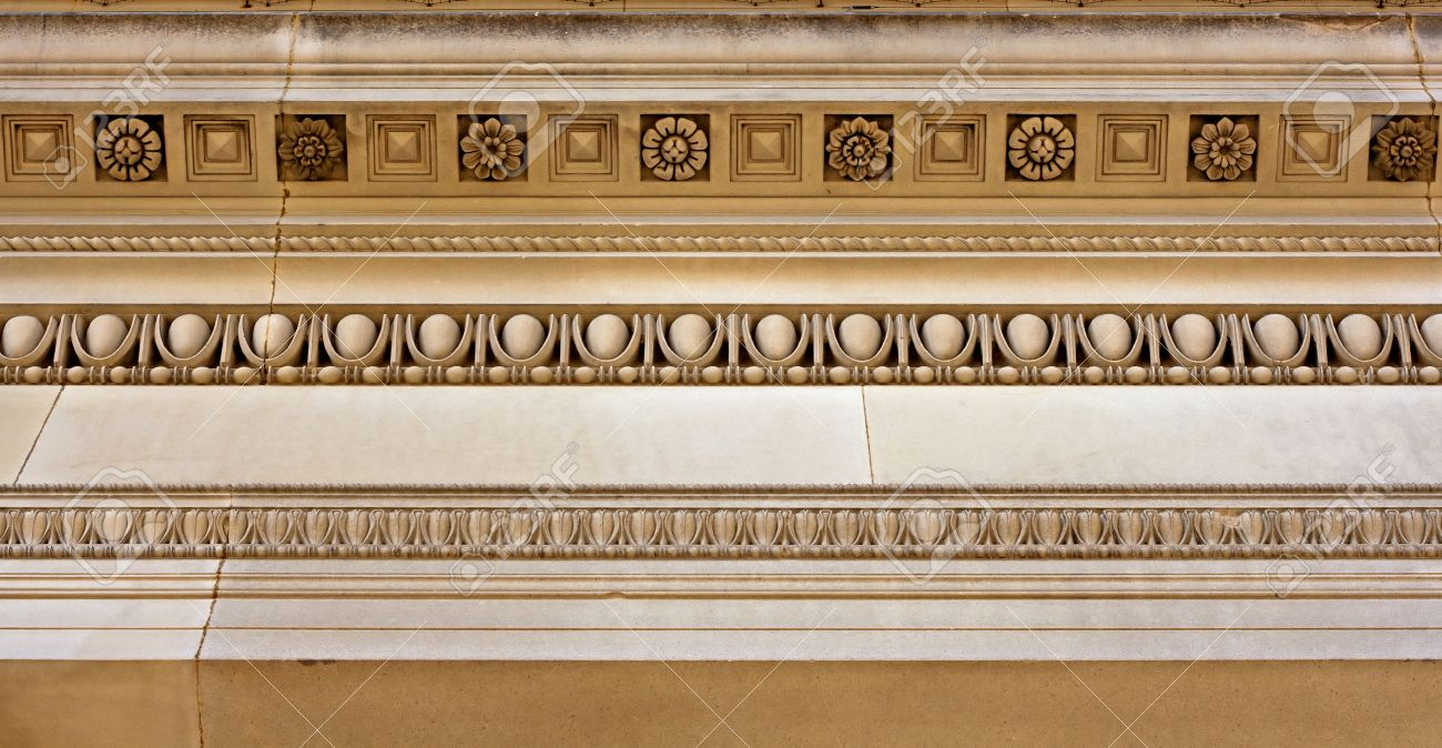 Intricate Cornice Mouldings On Sandstone Building Stock Photo