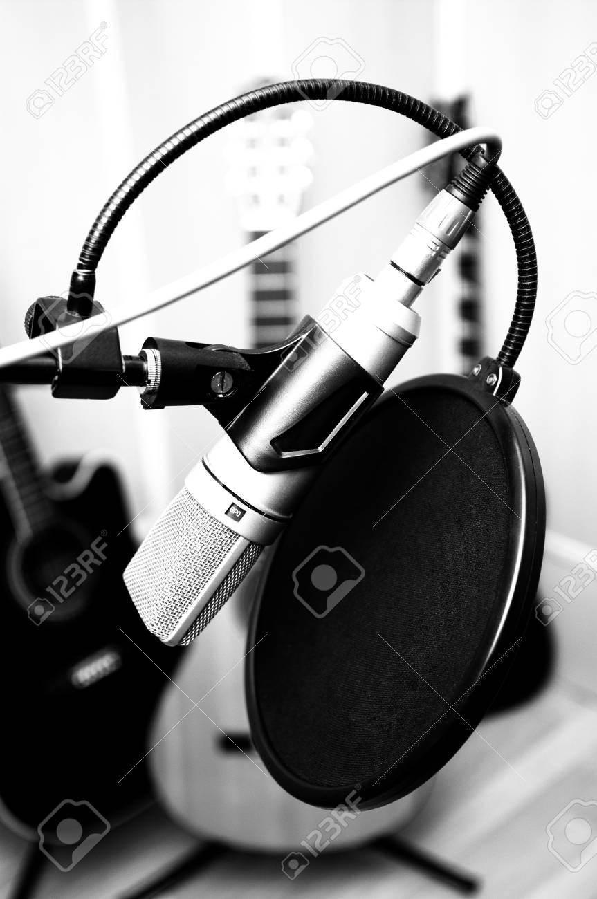 microphone and guitars in music studio Stock Photo - 23905387
