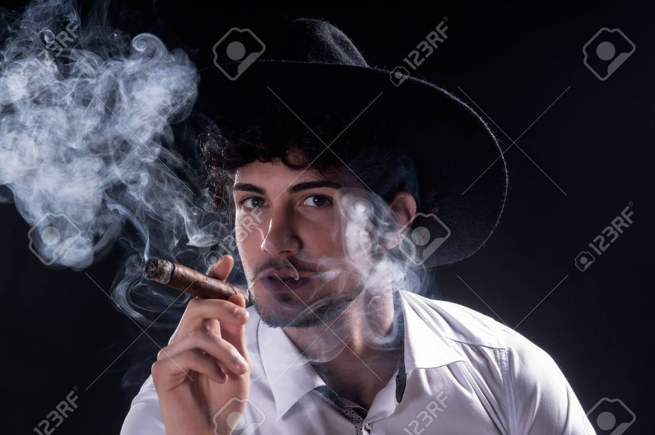 A Guy Smoking A Cigar Havana On A Dark Background Stock Photo Picture And Royalty Free Image Image 34438896