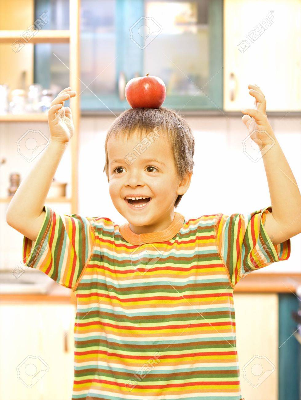 Happy boy with apple - balanced diet concept Stock Photo - 2780378