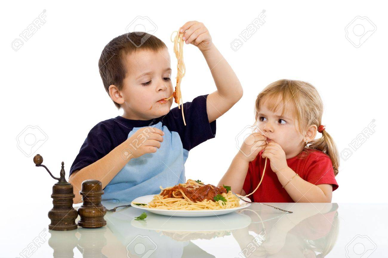 Two kids eating pasta with their hands - isolated Stock Photo - 3995505