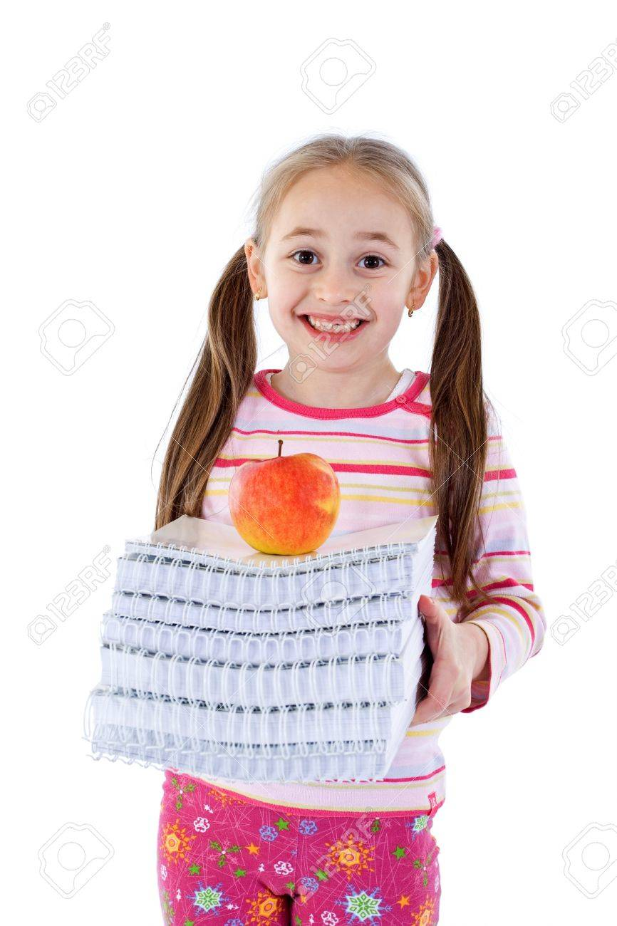 Little girl missing a tooth, anxious to go to school - isolated Stock Photo - 4085804