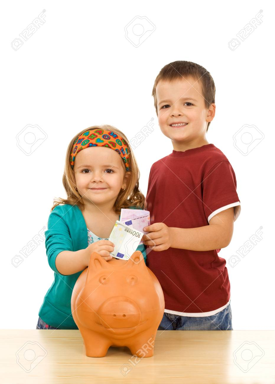 Financial education and discipline concept - kids feeding their piggy bank Stock Photo - 4979696