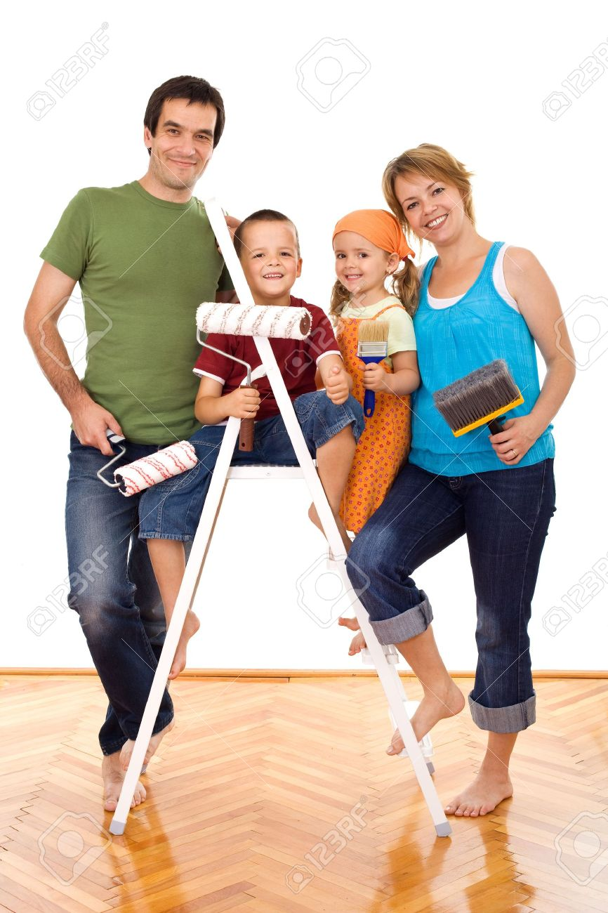 Happy family with painting utensils ready to repaint their home - isolated Stock Photo - 5186162