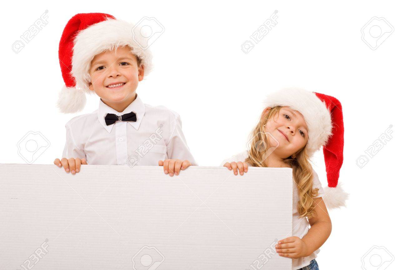 Kids with santa hats and white banner for text - christmas message, isolated Stock Photo - 5943516