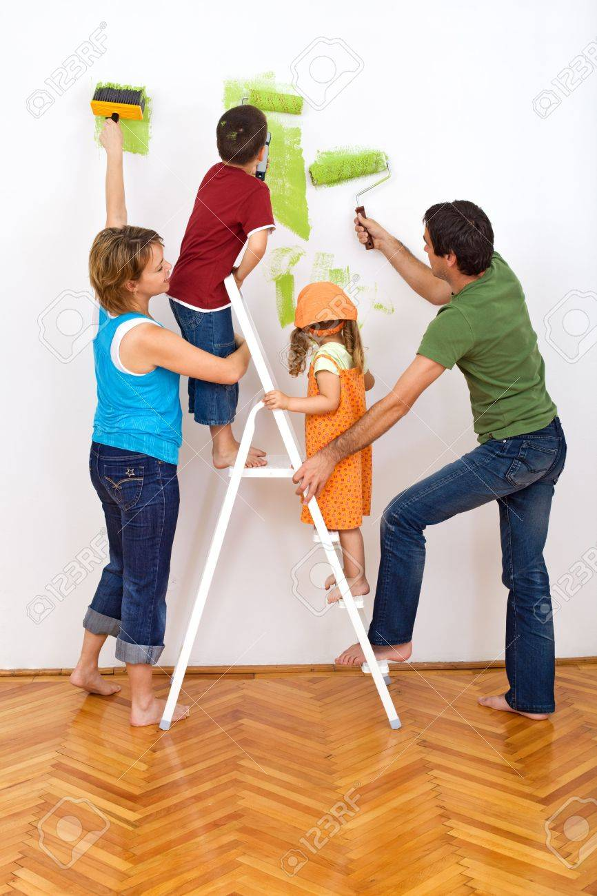 Happy Family Redecorating The House - Painting The Wall Stock Photo ...