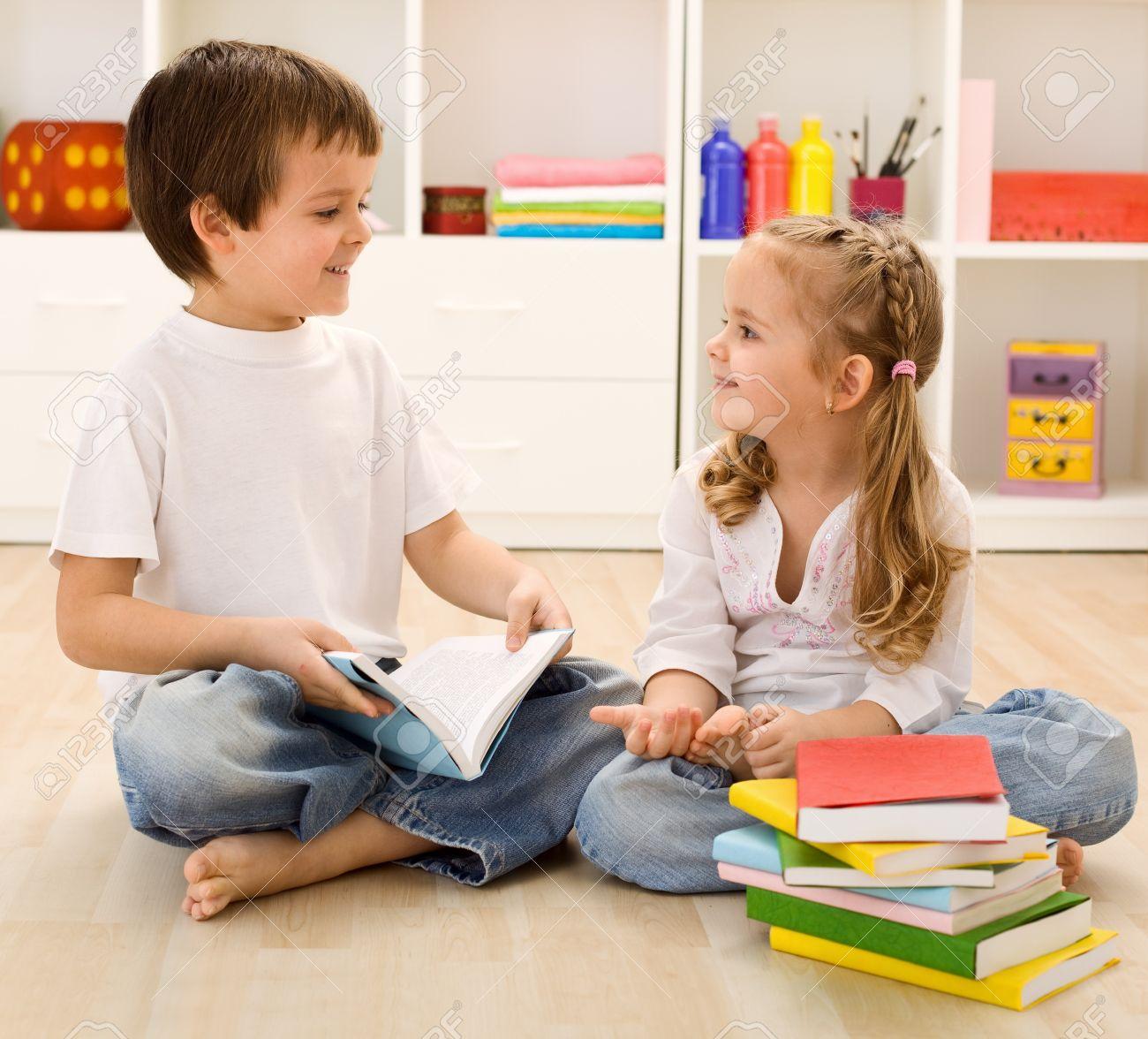 Boy Holding Popcorn While Siblings Talking At Stock Photo - Image ...